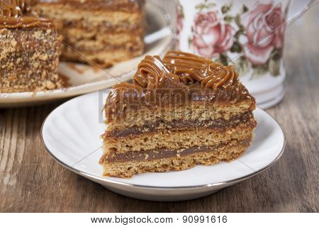 Piece Of Cake With Honey Shortcakes On A White Plate.