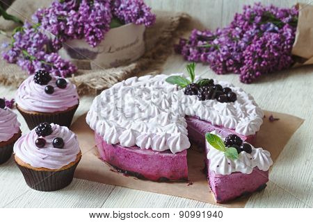 Blackerry purple souffle cake. Traditional delicious homemade baked sweet decorated with blackberry