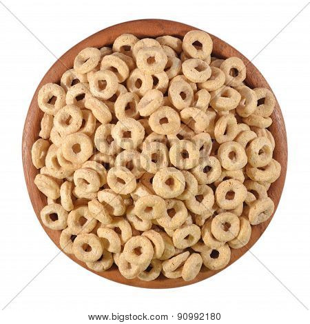 Breakfast Cereal Rings In A Wooden Bowl On A White