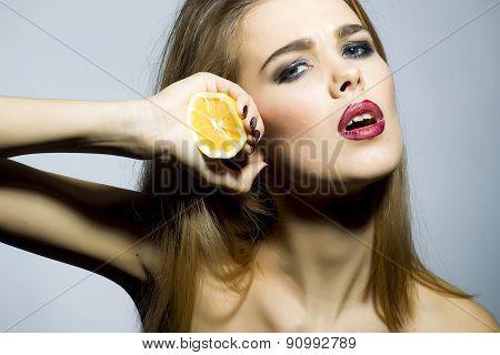 Pretty Blonde Girl Portrait With Orange