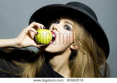 Beautiful Blonde Woman With Apple