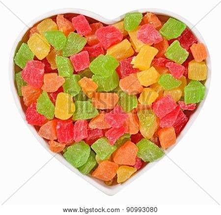 Candied Fruits In Plate In The Form Of Heart On A White
