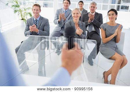Business team applauding during conference in meeting room