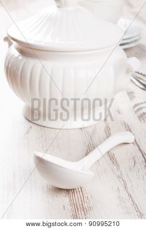 White soup tureen and ladle