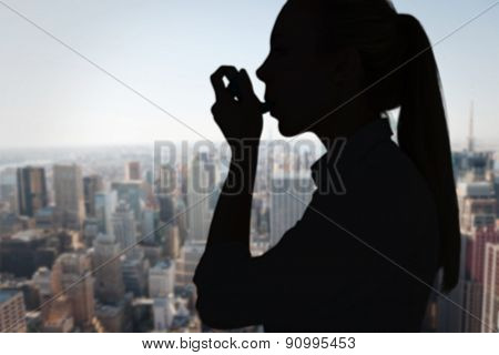 Beautiful blonde using an asthma inhaler against new york