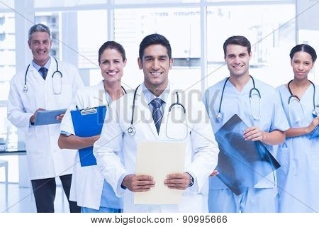 Portrait of confident doctors with arms crossed at medical office
