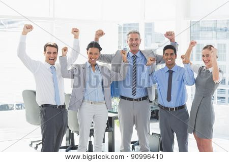 Portrait of cheerful business people cheering in the office