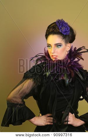 Beautiful Girl in High Fashion Make Up and Feathers