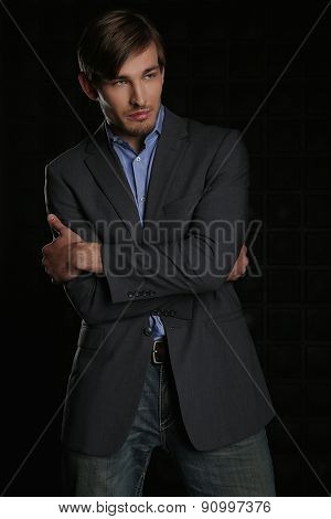 Portrait of Handsome Stylish Man in a Suit