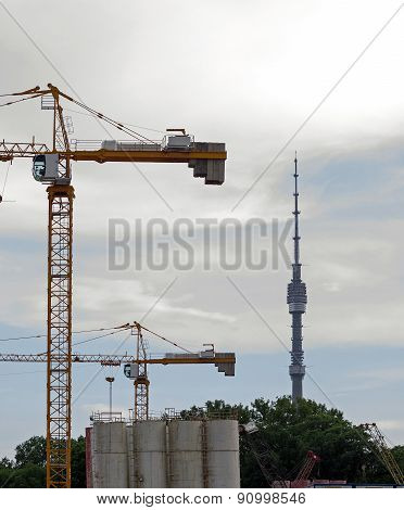 Russia, Moscow - Construction Cranes And Ostankino Tv Tower