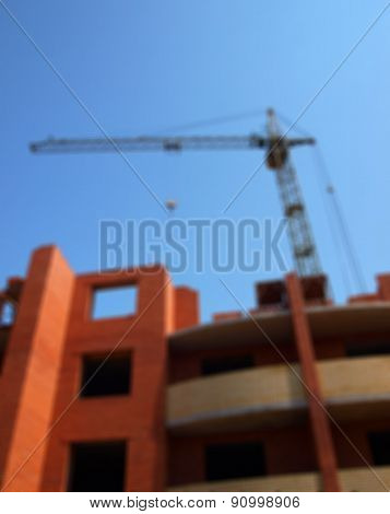 Defocused And Blur Image Of Building Under Construction With Crane