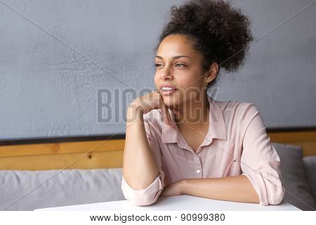 Young Woman Sitting Down And Thinking