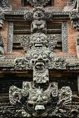 picture of monkeys  - Detail of architecture in Monkey temple at Bali Monkey forest Indonesia - JPG