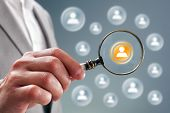 picture of recruitment  - Businessman with magnifying glass on team personnel or contact icon concept for recruitment - JPG