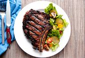 image of rib eye steak  - a rare rib steak cooked to perfection on the grill - JPG