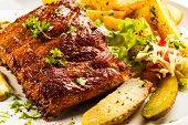 picture of ribs  - Tasty grilled ribs with vegetables  - JPG