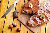 picture of hazelnut  - Two slices of bread with chocolate cream and hazelnuts on a wooden table top view - JPG