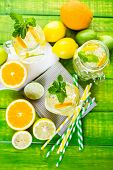 foto of infusion  - Infused water with fresh citrus fruits and ice - JPG