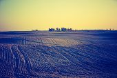 stock photo of plowed field  - Vintage photo of plowed field in calm countryside - JPG