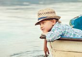 picture of life-boat  - Boy in straw hat lying in old boat - JPG