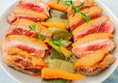 picture of duck breast  - baked duck breast with zucchini and carrots on white plate - JPG