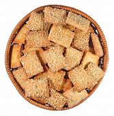 stock photo of sesame seed  - Cookies with sesame seeds in a wicker bowl on a white background - JPG