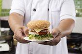 stock photo of hamburger  - Close up Chef presented Hamburger  - JPG