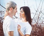 image of fondling  - Portrait of happy young couple outdoors - JPG