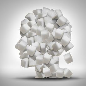 picture of addicted  - Sugar addiction concept as a human head made of white granulated refined sweet cubes as a health care symbol for being addicted to sweeteners and the medical issues pertaining to processed food - JPG