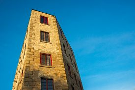 image of cornerstone  - An oddly shaped building featuring vintage architectural detail rises up against a bright blue sky with plenty of space for your copy - JPG