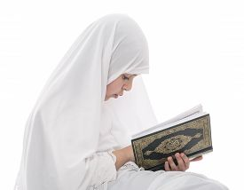 image of islamic religious holy book  - Little Young Muslim Girl Reading Quran Holy Book Isolated on White Background - JPG