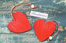 image of  friends forever  - Friends forever card with two red wooden hearts on rustic wood - JPG