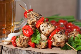 pic of bamboo  - Delicious traditional chicken or turkey kebab skewer barbecue meat with vegetables - JPG