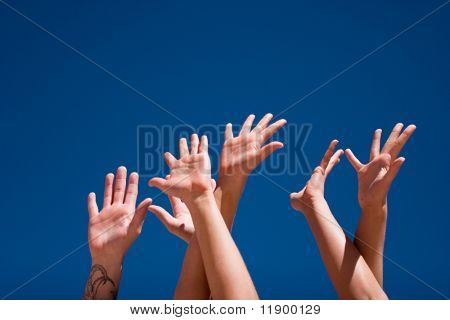 Group of people hands in the air