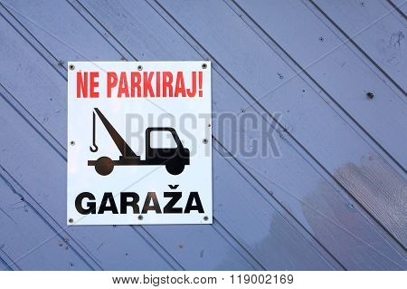 No parking area sign in slovenian language. Tow truck sign.