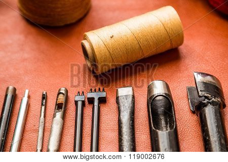 Leather crafting tools on work table