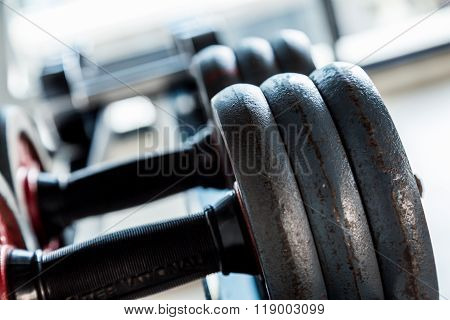 Dumbbells Weight Training Equipment In Gym Close Up