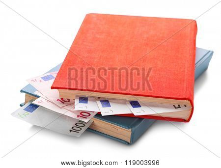 Books with nested euro banknotes, isolated on white. Stash of money