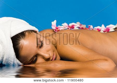Beautiful woman on massage table