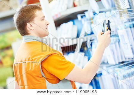hardware store salesman worker with arcode scanner