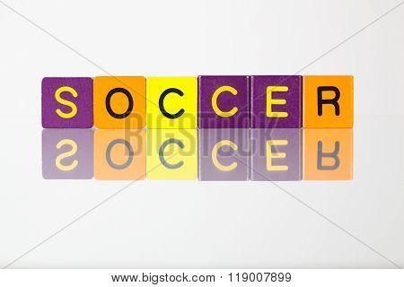 Soccer - an inscription from children's wooden blocks