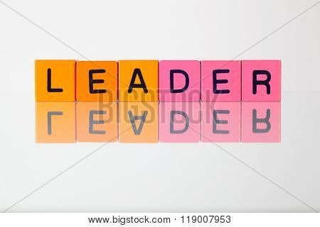Leader - An Inscription From Children's  Blocks