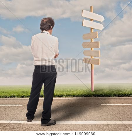 pensive businessman choosing the right direction