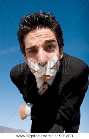 Businessman with a duct tape on his mouth