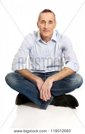 Man sitting cross-legged on the floor