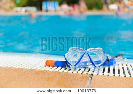 Blue diving mask and snorkel at the swimming pool