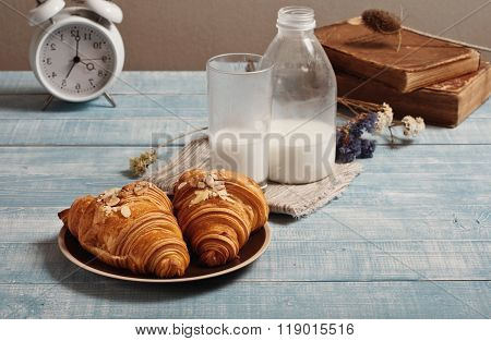 Two Croissant In Almonds On A Plate With Milk