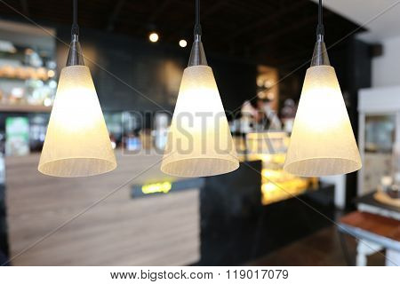 Warm Lighting Modern Ceiling Lamps In The Cafe.