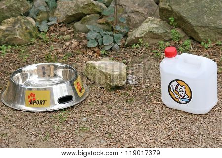 Prague, Czech Republic - April 26, 2010: Special Bowl And Canister With Water For Dogs In Prague Zoo