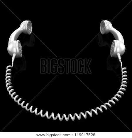 White old fashioned telephone handset isolated on a black